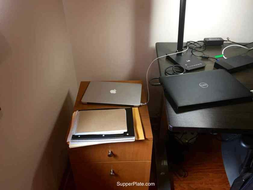 Small desk with closed laptop