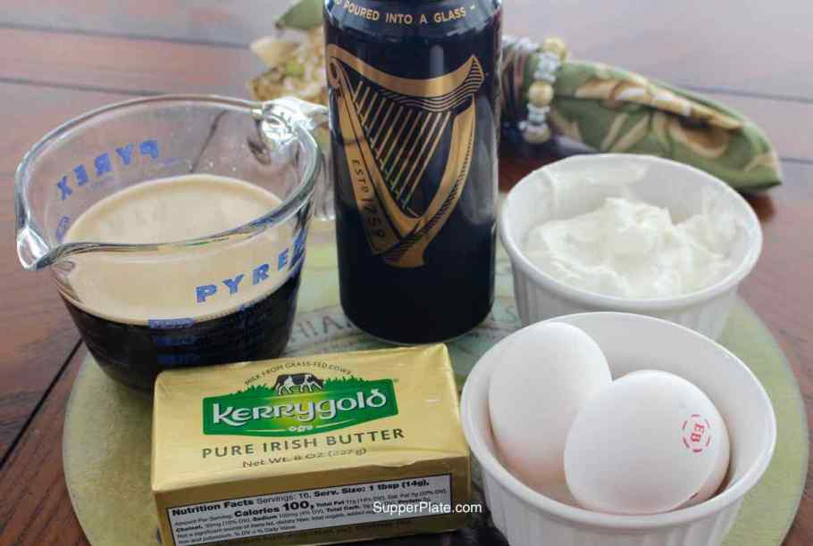 Guinness poured in a measuring cup, Kerrygold batter, eggs, sour cream on a green platter