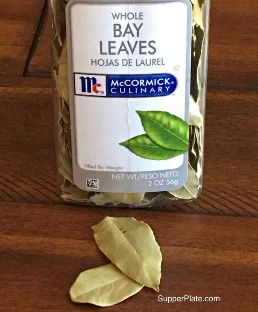 bay leaves on a table and in the container