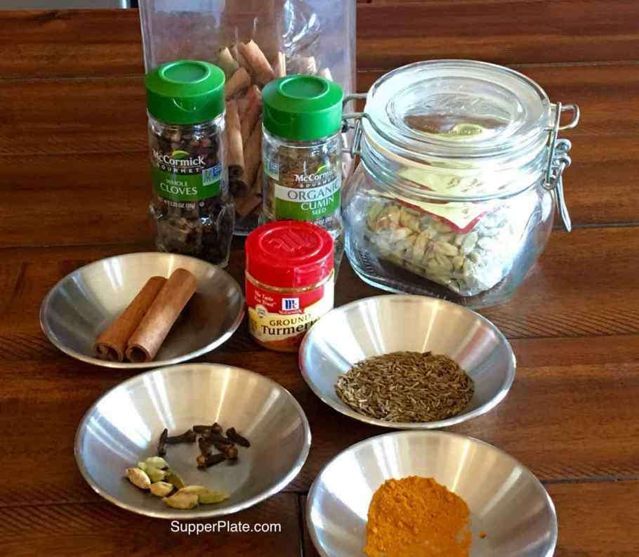 Spices measured in small bowls with spices in their original containers