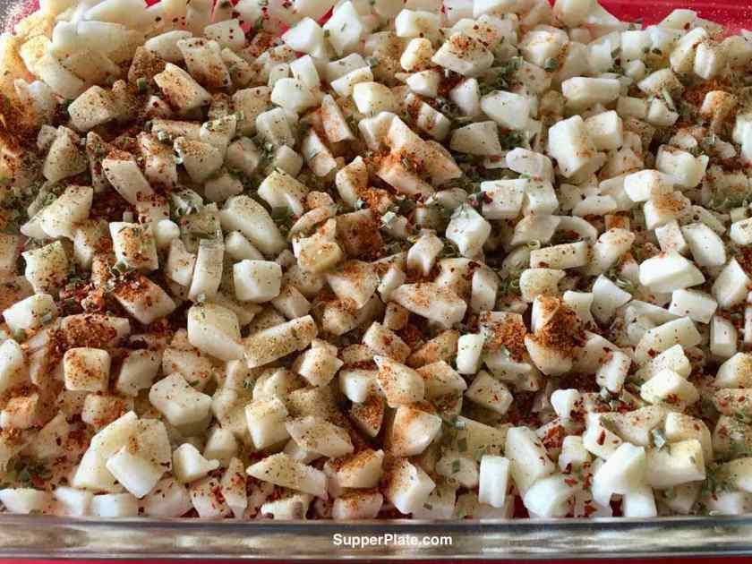 Potatoes seasoned in the casserole dish