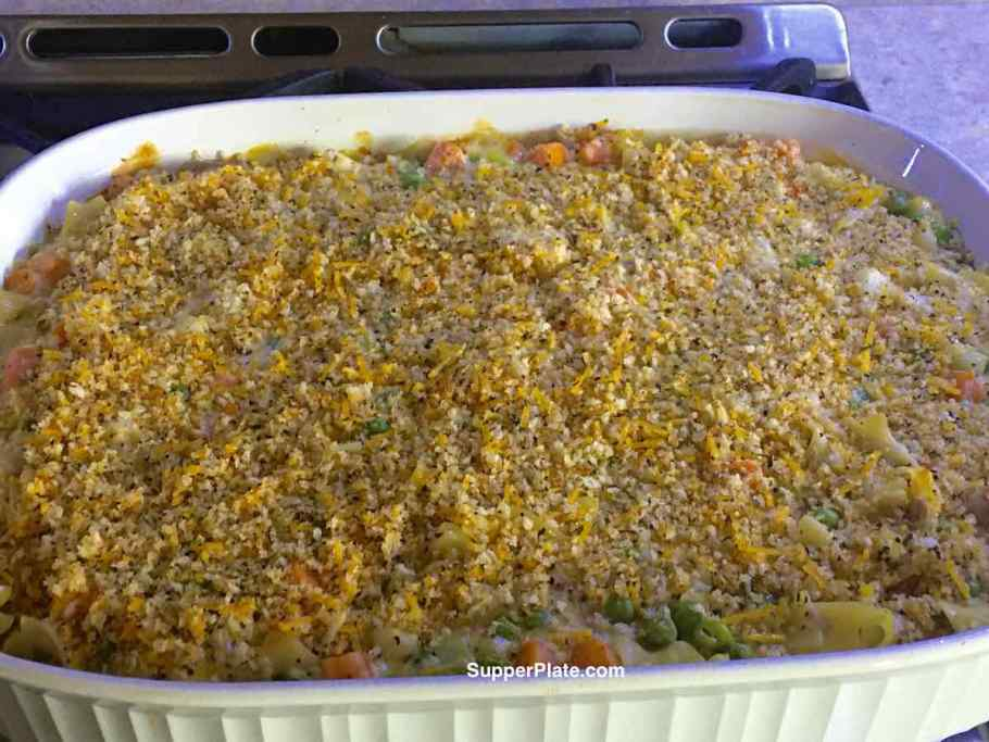 Baked Cheesy Tuna Noodle Casserole in a casserole pan out of the oven