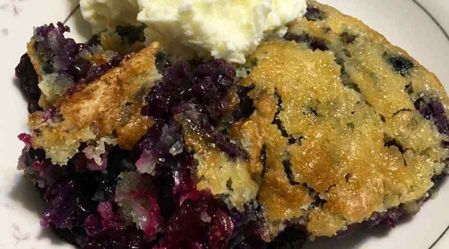 Blueberry Cobbler with lots of blueberries in a bowl with ice cream