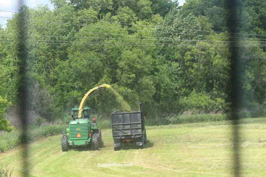 Tractor and truck moving a field
