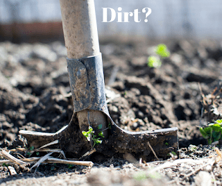A picture of a hoe in some dirt