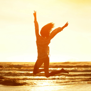 A girl jumping up into the air, because Vitamin D make you feel fabulous.