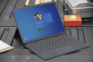A laptop showing a Windows 10 login screen.
