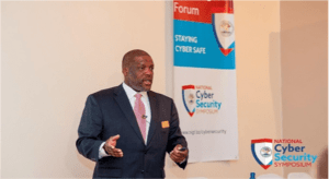 OmniSystems Chief Operating Officer - Reginald Vigilant speaks to an audience at the Belize National Cyber Security Symposium