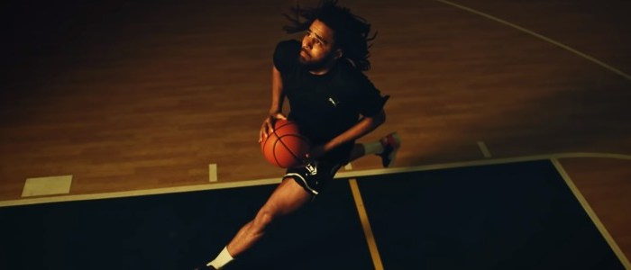 J Cole playing basketball at the courts