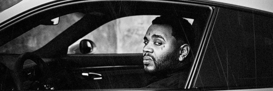 Kevin Gates in luxury car black and white