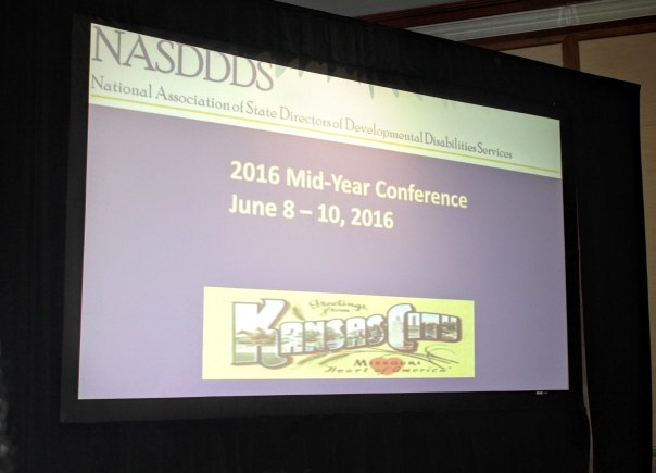 Photo: A photo of the main screen and the Welcome Powerpoint Slide at the 2016 NASDDDS Mid-Year Conference