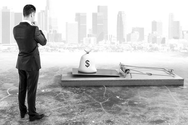 5 maneiras que o sistema financeiro nos mantem aprisionados