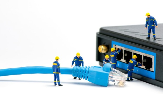 Technicians connecting network cable