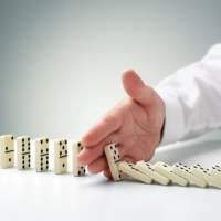 bigstock-stopping-the-domino-effect-con-73071721-720x480