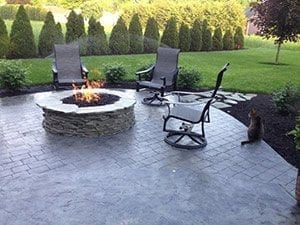 outdoor kitchen concrete patio fire pit