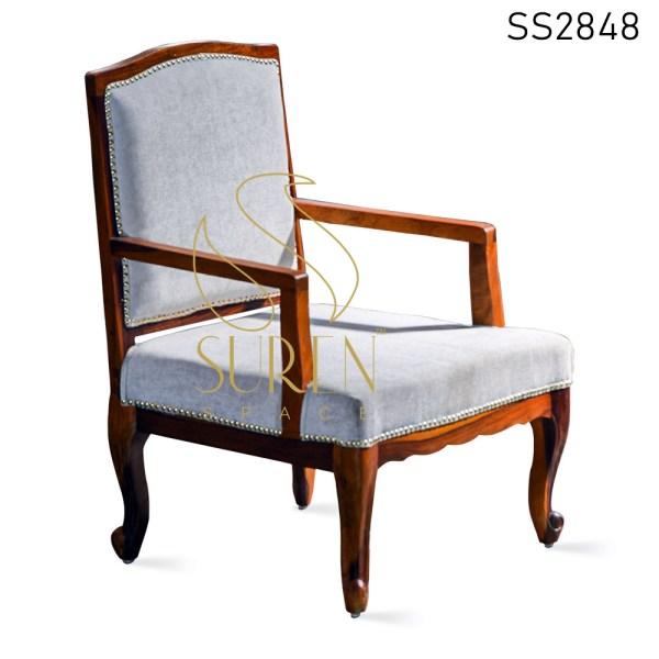 Carved Upholstered Teak Finish Rest Chair