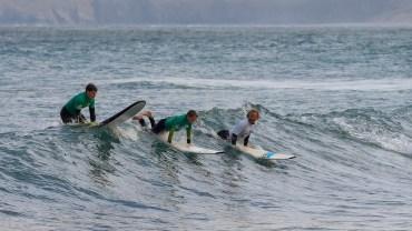 Surf lesson riding unbroken waves