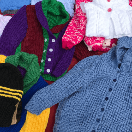 Julie celebrating her love of colour in knitted beanies and children's clothing.