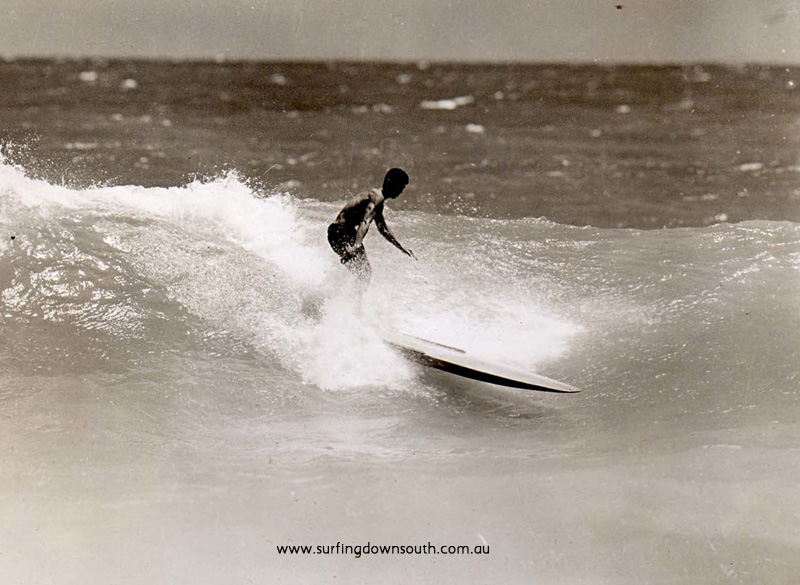 1957 City Beach northside of groyne. Brian Cole (18) riding home made hollow 10ft ply board - West picA