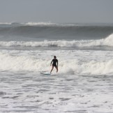 Here's Cindy on the inside of the same wave in the previous picture. She rode it all the way in to the beach.