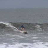 This is Liz on one of the friendlier waves of the day. She was able to get in early on her 9'4 and rode it all the way in to the sand.