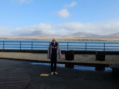 Me outside Caol Ila with Jura in the background