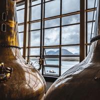 Caol Ila stills with a view of the Isle of Jura. Picture from: https://www.malts.com/en-row/distilleries/caol-ila/