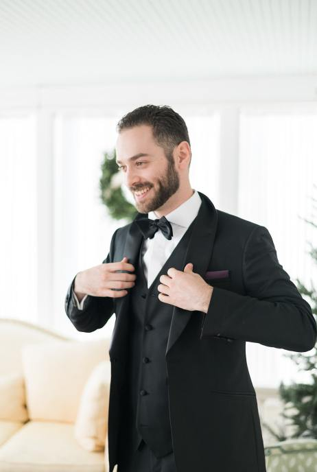 Man wearing a classic black tux for his wedding