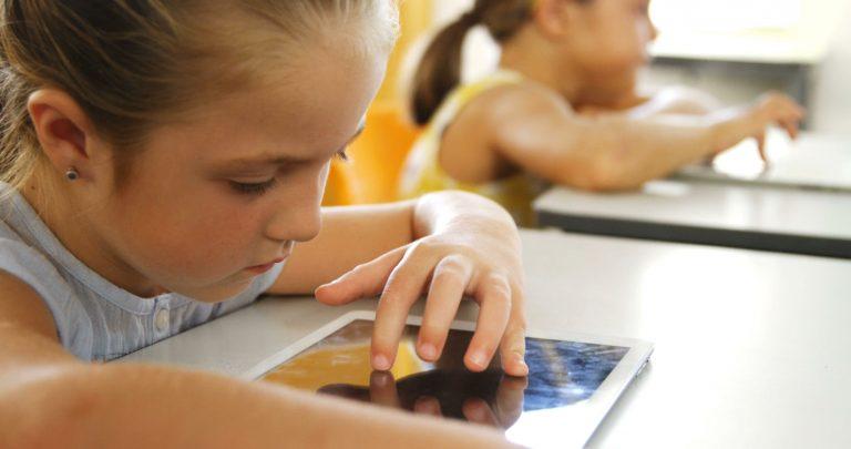 Children learning on tablets