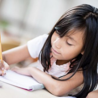 Girl studying at the school