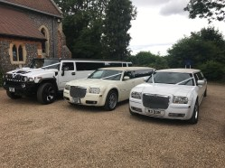 Two Chrysler Limousines and a Hummer on a wedding.