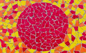 a red, orange, and yellow mosaic with a red circle at the center