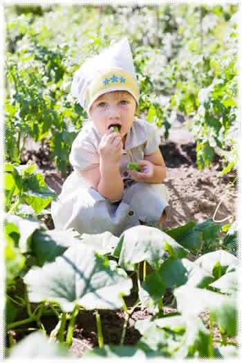 girl eating garden plant
