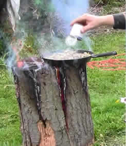 Using a Swedish Torch for Open Fire Cooking