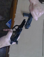 How to Clean a 1911 - Removing the slide on 1911 pistol.