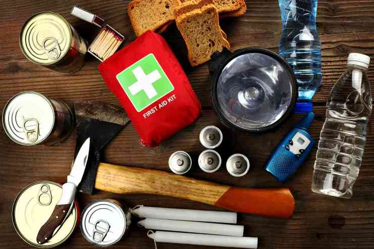 Items for emergency on wooden table | Prepping Tips For The Mobility Challenged