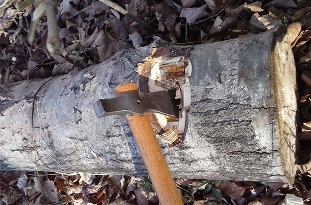 chopping wood with a tomahawk