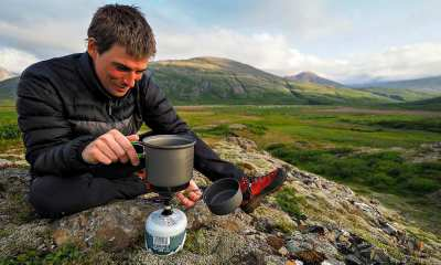 Feature | A man preparing to cook in the mountain | Improvised Survival Gear | DIY Projects For Preppers