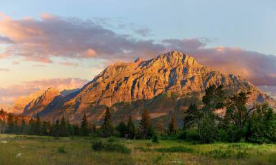 Feature | Panorama of the Mountains Outside the Going to the Sun Campground at Sunrise, Glacier National Park, Montana | Best Campgrounds In Montana