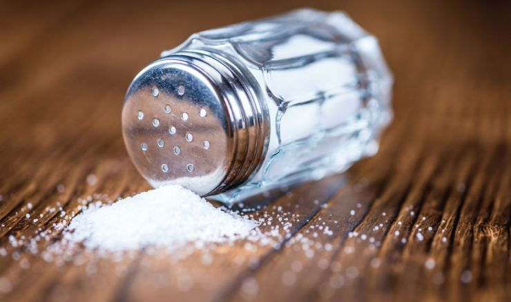 Old wooden table with a salt shaker | Fight An Ant Invasion Naturally With These Tips