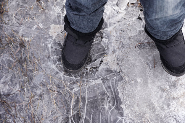 foot-cracking-thin-ice Thin Ice Ahead! How To Rescue Someone Who Has Fallen Through Ice