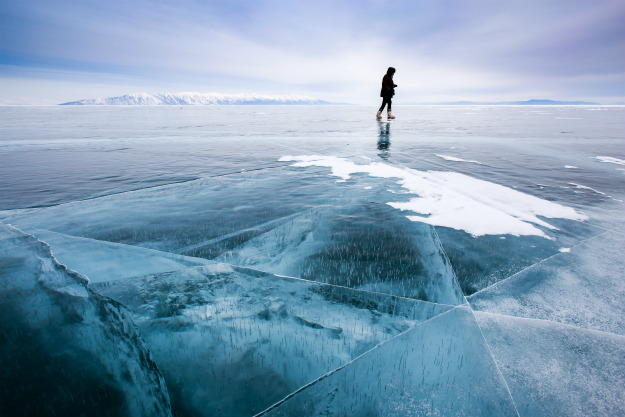 person-wakling-on-cracked-ice
