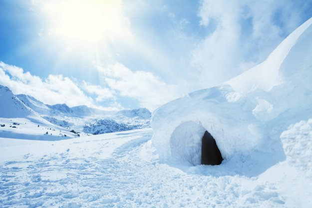 snow-shelter-on-side-of-hill Snow Shelter: Learn How to Build a Snow Cave For Winter Survival
