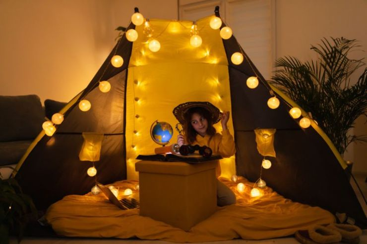 young-female-child-using-magnifying-glass camping light