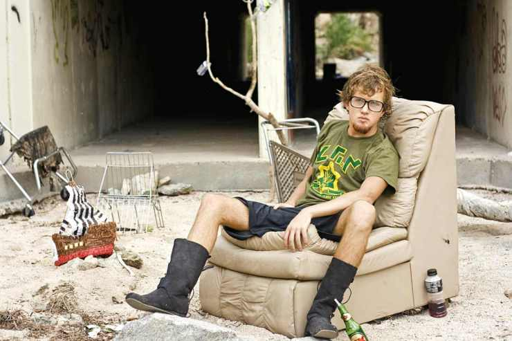 Homeless man wearing glasses sitting in the sofa | Homeless Survival Tips | How To Survive On The Streets