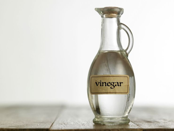White vinegar on the wooden table | Survival Food Items That Will Outlast The Apocalypse