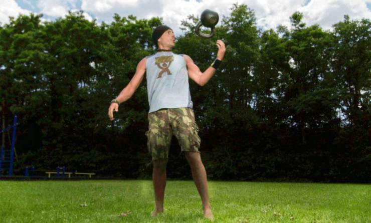 Man kettlebell workout in the park   Why The Kettlebell Is The Ultimate Tool For Physical Preparedness