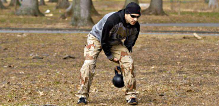 Man wearing bonnet kettlebell exercise   Why The Kettlebell Is The Ultimate Tool For Physical Preparedness