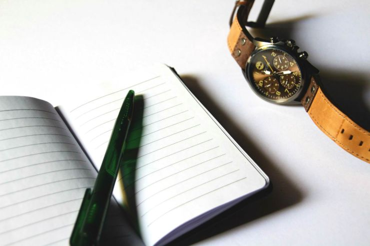 Close up of notebook, pen and watch on table | Building A Bug Out Bag