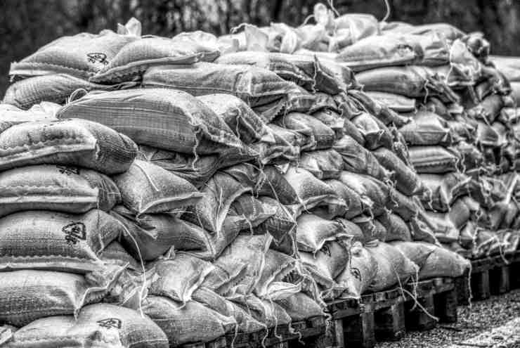 Pile of sandbags black and white background | Flood Survival Tips | How To Survive Before, During, And After A Flood